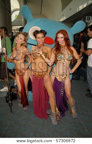 Paula Labaredas, Alicia Arden and Phoebe Price at the annual Slave Leia Group Photo at ComicCon, San Diego Convention Center, San Diego, CA. 07-23-10