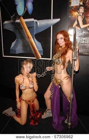 Paula Labaredas and Phoebe Price at the annual Slave Leia Group Photo at ComicCon, San Diego Convention Center, San Diego, CA. 07-23-10