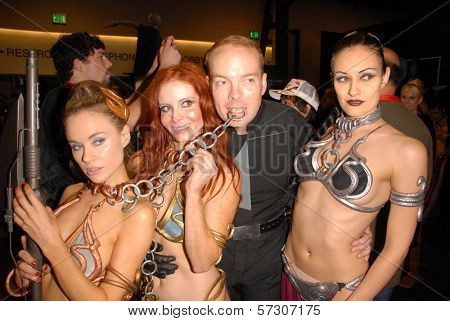 Paula Labaredas, Phoebe Price, Jamin Fite and Annisse at the annual Slave Leia Group Photo at ComicCon, San Diego Convention Center, San Diego, CA. 07-23-10
