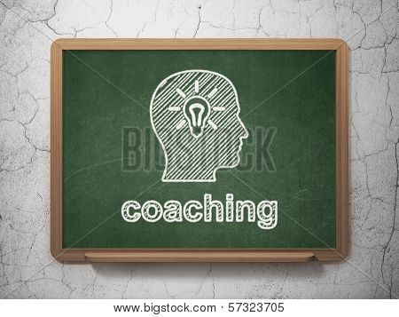 Education concept: Head With Light Bulb and Coaching on chalkboard background
