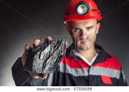 Coalminer Showing Lump Of Coal