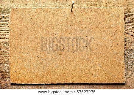 Cardboard On Wooden Wall
