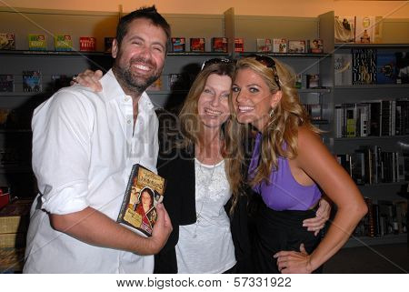 James Cox, Dawn Schiller and Bridgetta Tomarchio at a signing for Dawn Schiller's The Road Through