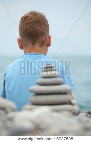 Boy And Stone Stack, Rear View