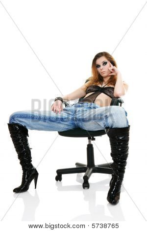Sexy fashion model sitting on chair