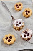 foto of augen  - Traditional Linzer Cookies with sugar and jam - JPG
