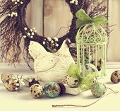 stock photo of quail  - Still Life With Quail Eggs and Easter wreath - JPG