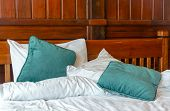 picture of pillowcase  - pillows and blankets on the messy bed - JPG