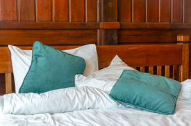 foto of pillowcase  - pillows and blankets on the messy bed - JPG