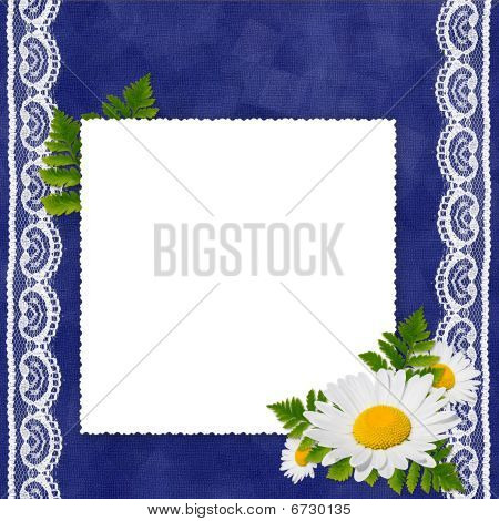 White Frame With Camomile, Leaf And White Laces On The Darkblue Background