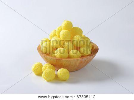 wooden bowl of corn puffs