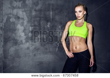 fitness lifestyle portrait, caucasian model, trained body, copyspace