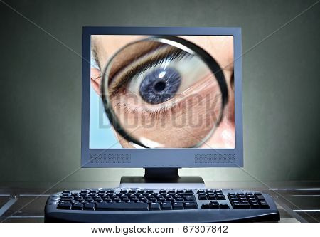 Eye With Magnifier In A Computer Monitor