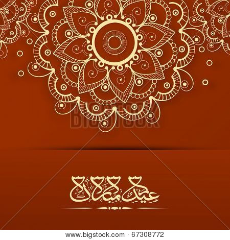 Arabic Islamic calligraphy of text Eid Mubarak on golden floral decorated brown background for Muslim community festival celebrations.
