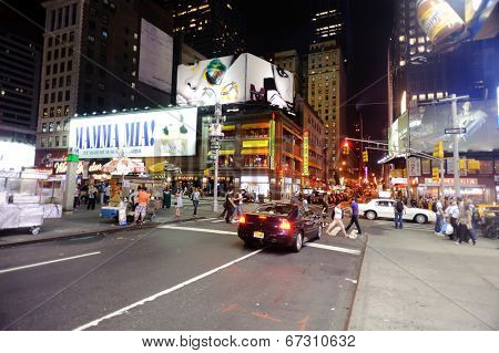 NEW YORK - SEPTEMBER 25: area near Times Square at night on September 25, 2011 in New-York. Times Square is a major commercial intersection and a neighborhood in Midtown Manhattan, New York City.