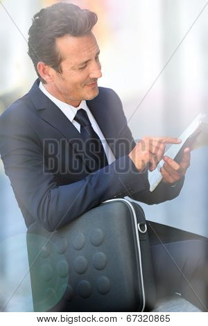Attractive businessman in town talking on mobile phone