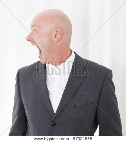 Man In Suit Making A Grimace