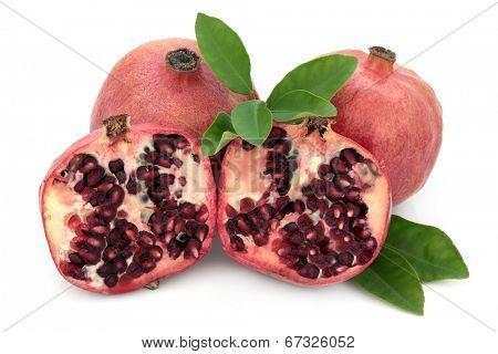 Pomegranate fruit super food over white background.