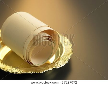 roll of the adding machine tape in the tray
