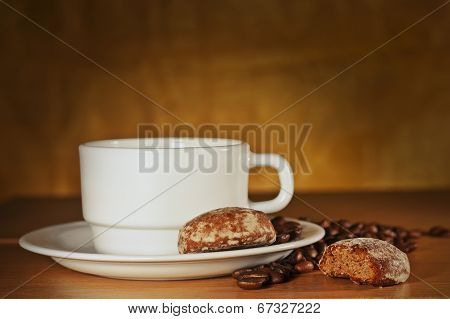 White Cup Of Coffee With Coffee Beans And Cakes