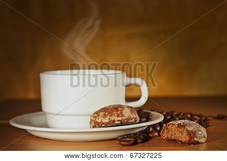 White Cup Of Coffee And Cakes On A Plate