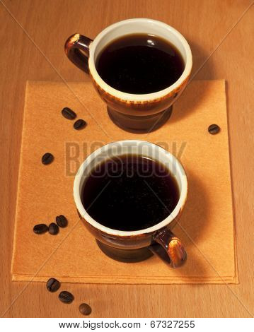 Two Cups Of Coffee On A Napkin