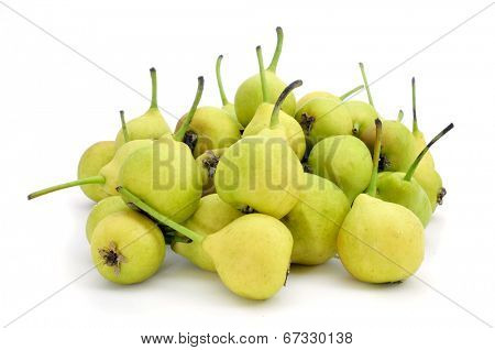 a pile of peras de San Juan, typical spanish small pears, on a white background