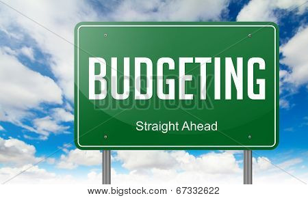 Budgeting on Green Highway Signpost.