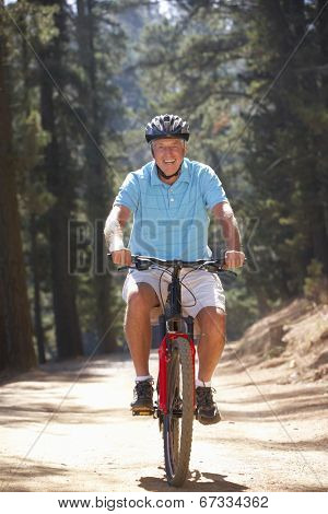 Senior man on country bike ride
