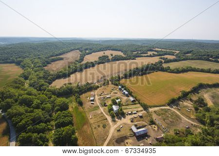Aerial view of farm fields and trees in mid-west Missouri early morning