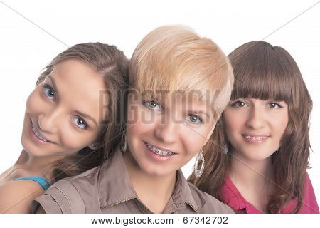 Portrait Of Three Young Ladies With Teeth Braces Together