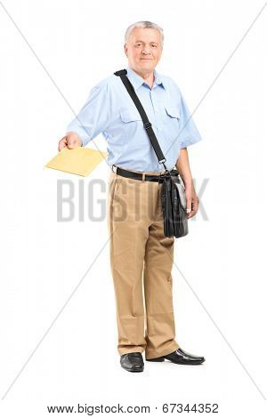 Full length portrait of a mailman handing an envelope towards the camera isolated on white background