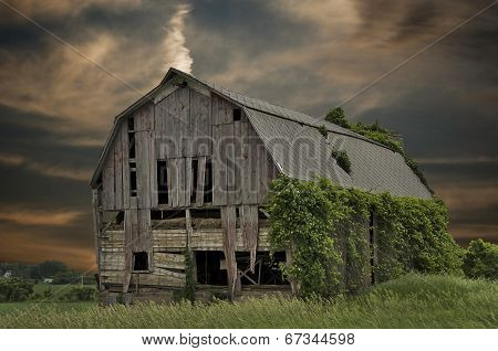 dilapidated barn at sunset