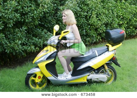 Beautiful Woman On Motor Scooter