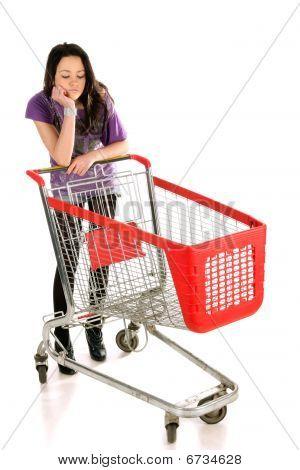 Unhappy Girl With Shopping Cart