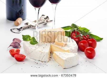 Tow Wineglass With Red Wine And Assortment Of Cheese On White Background