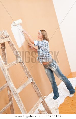 Home Improvement: Woman Painting Wall