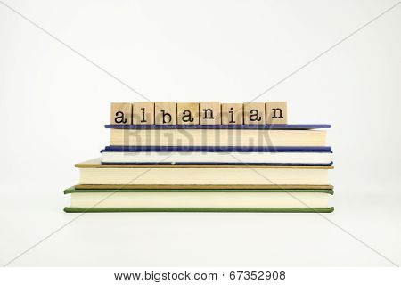 Albanian Language Word On Wood Stamps And Books