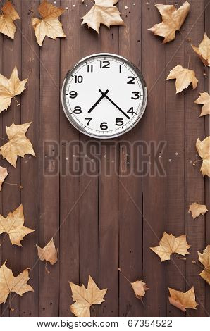 Clock And Leaves Around