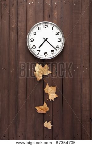Clock With Some Leaves As Pendulum