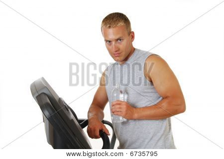 Man Drinking Water On A Treadmill