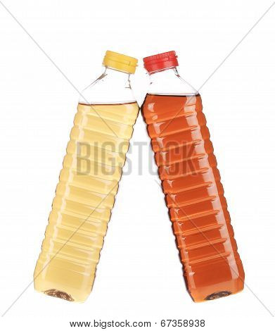close up of bottles with apple and grape vinegar