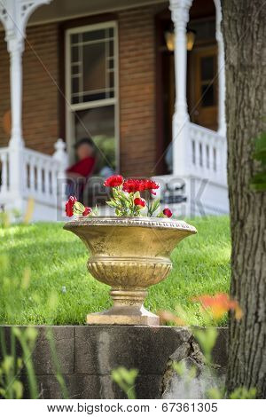 Potted Flowers In Front Of An Old Nebraska Home