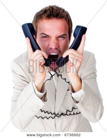 Stressed Businessman Tangle Up In Phone Wires