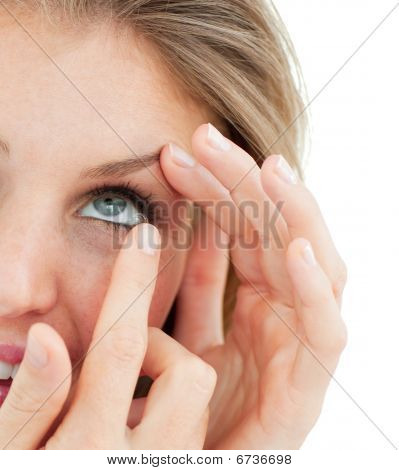 Close-up Of A Woman Putting A Contact Lens