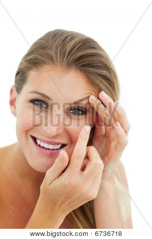 Smiling Woman Putting A Contact Lens