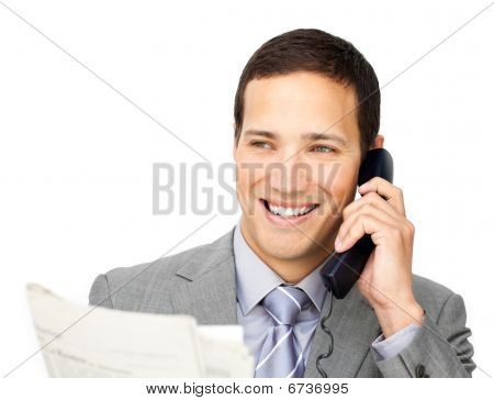 Positive Businessman On Phone Holding A Newspaper