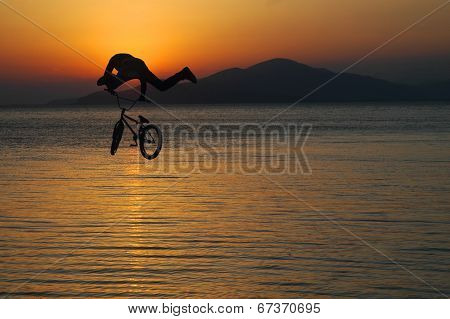 Silhouette Of A Man Doing A Jump With