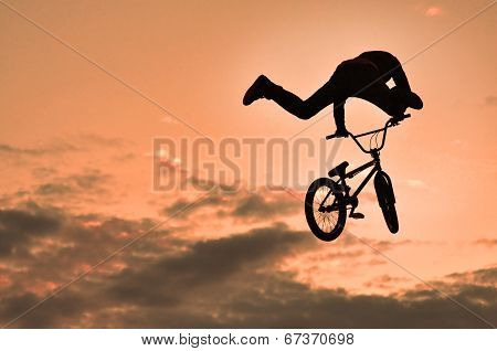 Silhouette Of A Man Doing A Jump With A Bike
