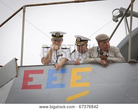 STATEN ISLAND, NY - MAY 21: The conning officer, commander, and harbor master aboard the USS Cole (DDG 067) guide the ship into port at Sullivans Piers for Fleet Week NY on May 21, 2014.